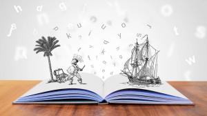 Obrazek przedstawia książkę z której wypadają literki